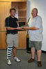 Newly elected Josh Berka presents Dave Huling with a plaque